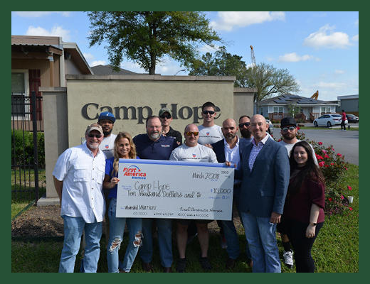 First America Homes makes a donation to Veterans at Camp Hope